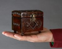 Small wooden brown jewelry box.