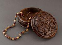Handmade round wooden decorative jewelry box.
