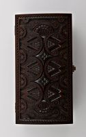 Wooden rectangular jewelry box with hand carved pattern.