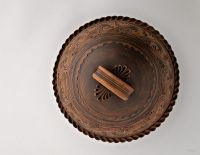 Brown ceramic bowl, plate with lid made of red clay.