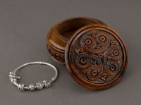 Hand carved round wooden brown jewelry box.