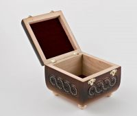 Wooden jewelry box inlaid with beads.