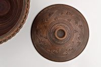 Ceramic brown bowl with lid made of red clay by hand.