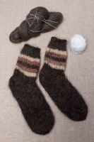 Warm hand knitted woolen socks for women and men.
