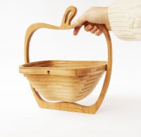 Fruit wooden transformer bowl made of natural wood.