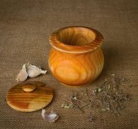 Wooden pot with lid.