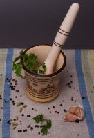 Wooden mortar and pestle for grinding spices by hand.