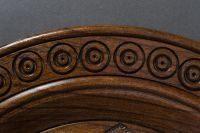 Handmade wall wooden plate with carved pattern.