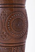 Decorative wooden table vase inlaid with beads.
