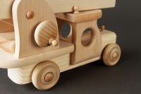 Children's wooden fire engine for play and creativity.
