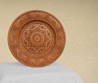 Interior plate with art carving and bead inlay