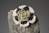 Handmade leather brooch in the form of a flower