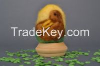 Egg on a wooden holder