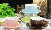 color coffee cup and saucer