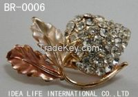 plating and stones brooch