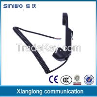 Military telephone handset with dynamic noise-cancelling microphone