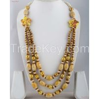 Fashion Necklaces - A bit of floral inspiration with three-layered neck piece attached to white Pearls.